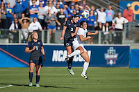 Cary, North Carolina - Sunday December 6, 2015: Kayla McCoy (12) of the Duke Blue Devils battles for a jump ball with Kaleigh Riehl (3) of the Penn State Nittany Lions during second half action at the 2015 NCAA Women's College Cup at WakeMed Soccer Park.  The Nittany Lions defeated the Blue Devils 1-0.