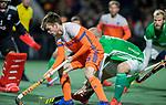 AMSTELVEEN - Thierry Brinkman (Ned) met rechts Eugene Magee (IRE)     tijdens de hockeyinterland Nederland-Ierland (7-1) , naar aanloop van het WK hockey in India.  COPYRIGHT KOEN SUYK