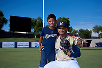 AZL Brewers Gold Andres Melendez (22) poses for a photo with his little brother before an Arizona League game against the AZL Brewers Blue on July 13, 2019 at American Family Fields of Phoenix in Phoenix, Arizona. The AZL Brewers Blue defeated the AZL Brewers Gold 6-0. (Zachary Lucy/Four Seam Images)