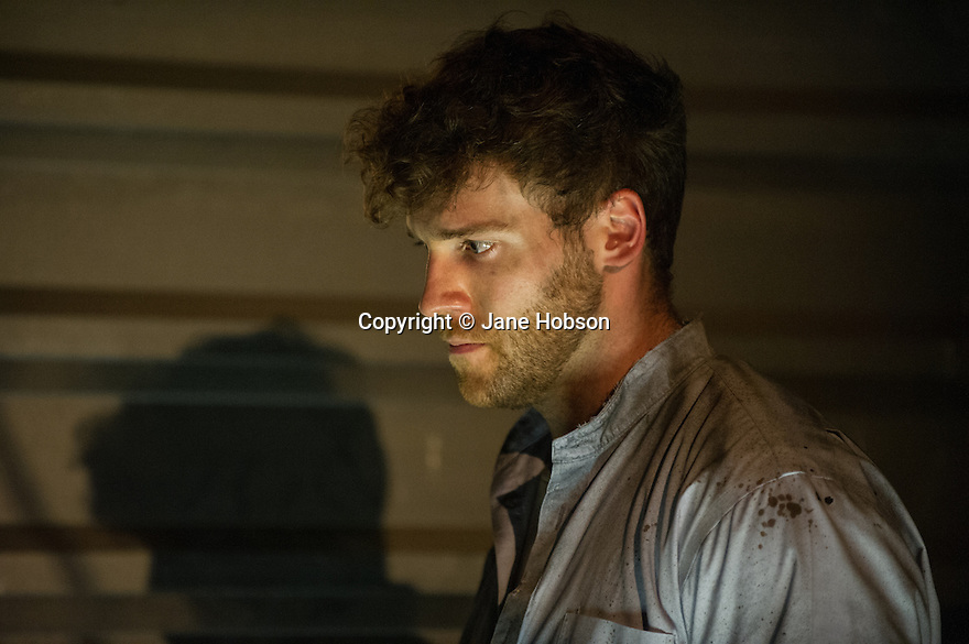 London, UK. 19.07.2013. Secret/Heart presents the world premiere of a new adaptation of Herman Melville's BILLY BUDD, at Southwark Playhouse. Cast is : Charlie Archer (Billy), Iain Batchelor (Jenkins), Hugo Bolton (Squeak), Luke Courtier (Vere), Joel Gorf (Dansker), Oliver King (Ratcliffe), Jonathan Leinmuller (Talbot), Gerrard McArthur (Claggart), and Christopher Hammond (O'Daniel). Photograph. Directed by Seb Harcombe, with lighting design by Howard Hudson and set and costume design by Nicolai Hart-Hansen. © Jane Hobson.
