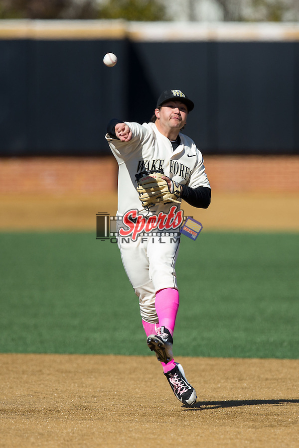 Wake Forest Demon Deacons second baseman Nate Mondou (10) makes an off balance throw to frist base during the game against the Virginia Tech Hokies at Wake Forest Baseball Park on March 7, 2015 in Winston-Salem, North Carolina.  The Hokies defeated the Demon Deacons 12-7 in game one of a double-header.   (Brian Westerholt/Sports On Film)