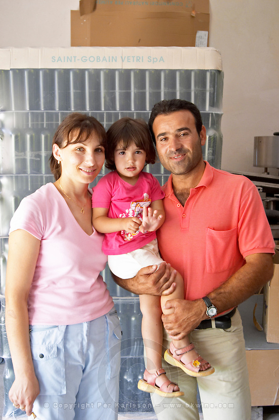 Mr Petrit Cobo with his wife and daughter in the new winery. Cobo winery, Poshnje, Berat. Albania, Balkan, Europe.