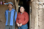 Rosa Antesano and her husband Jose Ortega in the doorway of their house in the Guarani indigenous village of Choroquepiao, in the Chaco region of Bolivia. They and their neighbors started family gardens with assistance from Church World Service, supplementing their corn-based diet with nutritious vegetables and fruits.