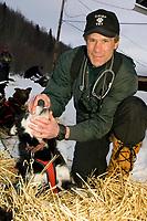 Chief Vet Stu Nelson Checks Vern Halters Dogs @ Takotna Chkpt 2005 Iditarod AK IN