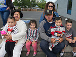 The Ramirez family watch the Reno Rodeo Parade held in Midtown on Virginia Street on Saturday, June 18, 2016.