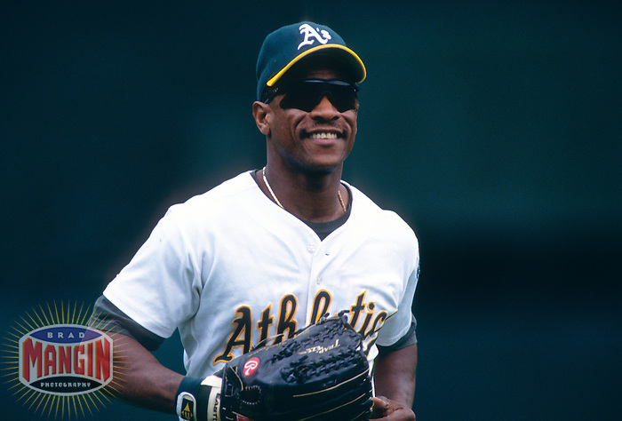 OAKLAND, CA - Rickey Henderson of the Oakland Athletics in action smiling during a game at the Oakland Coliseum in Oakland, California in 1998. Photo by Brad Mangin