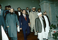 The end of the meeting between the leader of the United Tajik Opposition S.A. Nuri and the Tajikistan president Rakhmonov, in a tentative of peace and reconciliation made by the Afghan President Borhan'udin Rabani in 1995 at the President palace in Kabul, Afghanistan..During 1992 to 1997, Tajikistan suffer civil war...Emomali Sharipovich Rakhmonov (born October 5, 1952) has been the President of Tajikistan since 1994 (and the head of state since 1992)..He was born to a peasant family in Dangara, in Koolyab (Kuljab) province. His original power base was as chairman of the collective state farm of his native Dangara, and in 1990 he was elected people's deputy of the Supreme Council of the Tajik SSR. He was confirmed by re-election as chairman of the Supreme Council of an independent Tajikistan in 1992, after the resignation of the pro-Communist Rahman Nabiyev..On November 6, 1994, Rahmonov was elected to the newly created post of president of Tajikistan, and he was sworn in on November 16. Following constitutional changes, he was re-elected on November 6, 1999 to a seven-year term, taking 97% of the vote. On June 22, 2003, he won a referendum that would allow him to run for two more consecutive seven-year terms after his present term expires in 2006. The opposition alleges that this amendment was hidden in a way that verged upon electoral fraud.