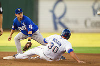 Las Vegas 51s shortstop Jonathan Diaz #6 waits for a throw as baserunner Brad Nelson #30 slides into second base during the Pacific Coast League baseball game against the Round Rock Express on August 7th, 2012 at the Dell Diamond in Round Rock, Texas. The Express defeated the 51s 5-4. (Andrew Woolley/Four Seam Images).