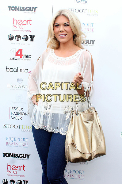 Frankie Essex.Arrivals at Essex Fashion Week show at Woolston Manor Country Club, Chigwell, Essex, UK, October 29th 2011..half length white top hand on hip gold bag jeans TOWIE  sheer .CAP/JIL.©Jill Mayhew/Capital Pictures