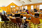 Kerry County Council staff working in the Call cetnre set up in the Council chamber.