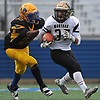 Anthony D'onofrio #37, right, races upfield on a punt return as David Grayson #37 of Lawrence looks to chase him down in the Nassau County Conference III varsity football final at Hofstra University on Saturday, Nov. 18, 2017. Lawrence won by a score of 21-10.