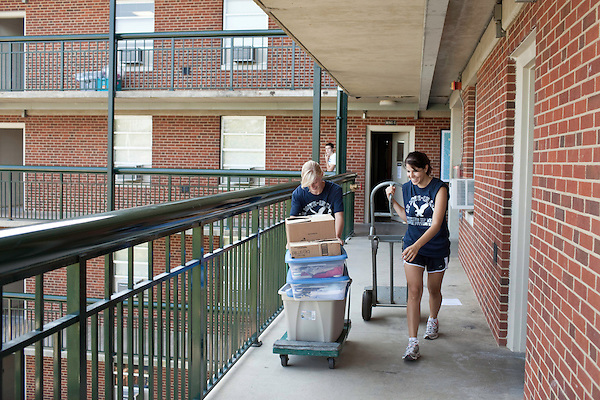 August 20, 2011. Chapel Hill, NC.. American Eagle student volunteers (left to right) Astin Barnes and Pinelopi Kyriazi helped incoming freshmen move into their new dorm rooms. They were 2 of many American Eagle student volunteers who fanned out around the UNC campus on move in day to raise awareness of the brand by giving out coupons and helping incoming students move in to the dorms.. Many companies have increased their efforts to reach the youth market by employing popular college students to raise the awareness of the brand by peer to peer marketing on campus' around the country.
