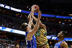 10 March 2016: Duke's Marshall Plumlee (left) blocks a shot by Notre Dame's Bonzie Colson (35). The University of Notre Dame Fighting Irish played the Duke University Blue Devils at the Verizon Center in Washington, DC in the Atlantic Coast Conference Men's Basketball Tournament quarterfinal and a 2015-16 NCAA Division I Men's Basketball game. Notre Dame won the game 84-79 in overtime.
