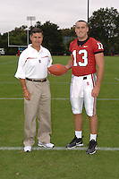 7 August 2006: Stanford Cardinal head coach Walt Harris and T.C. Ostrander during Stanford Football's Team Photo Day at Stanford Football's Practice Field in Stanford, CA.