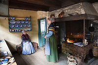 Costume characters and interior at Den Gamle By, The Old Town, open-air folk museum at Aarhus,  East Jutland, Denmark