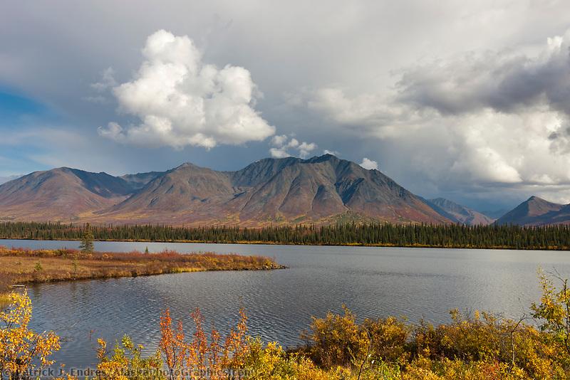 Dramatic clouds over the Alaska Range mountains, tundra pond, broad pass, Interior, Alaska.