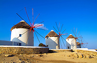 Windmills on beach, Mykonos, Greece