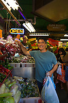 Celebrity chef Roy Yamaguchi shopping for produce in Honolulu's Chinatown.  Chef Roy opened Roy's which serves Hawaiian Fusion Cuisine using locally sourced ingredients.  He is Hawaii's first ever James Beard Award winner and is the host of the television show, Hawaii Cooks.