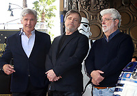 LOS ANGELES, CA - MARCH 8: Harrison Ford, Mark Hamill and George Lucas at the Hollywood Walk Of Fame Ceremony honoring Mark Hamill in Los Angeles, California on March 8, 2018. <br /> CAP/MPI/FS<br /> &copy;FS/MPI/Capital Pictures