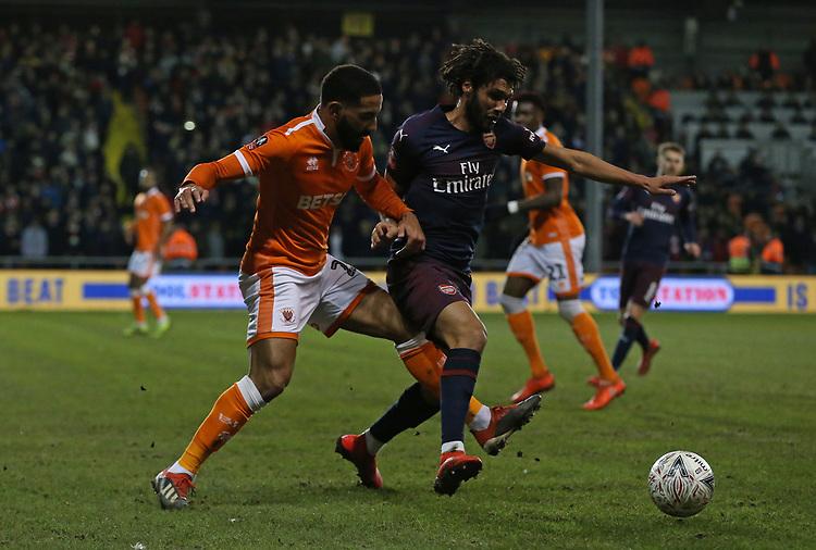 Arsenal's Mohamed Elneny shields the ball from Blackpool's Liam Feeney<br /> <br /> Photographer Stephen White/CameraSport<br /> <br /> Emirates FA Cup Third Round - Blackpool v Arsenal - Saturday 5th January 2019 - Bloomfield Road - Blackpool<br />  <br /> World Copyright &copy; 2019 CameraSport. All rights reserved. 43 Linden Ave. Countesthorpe. Leicester. England. LE8 5PG - Tel: +44 (0) 116 277 4147 - admin@camerasport.com - www.camerasport.com