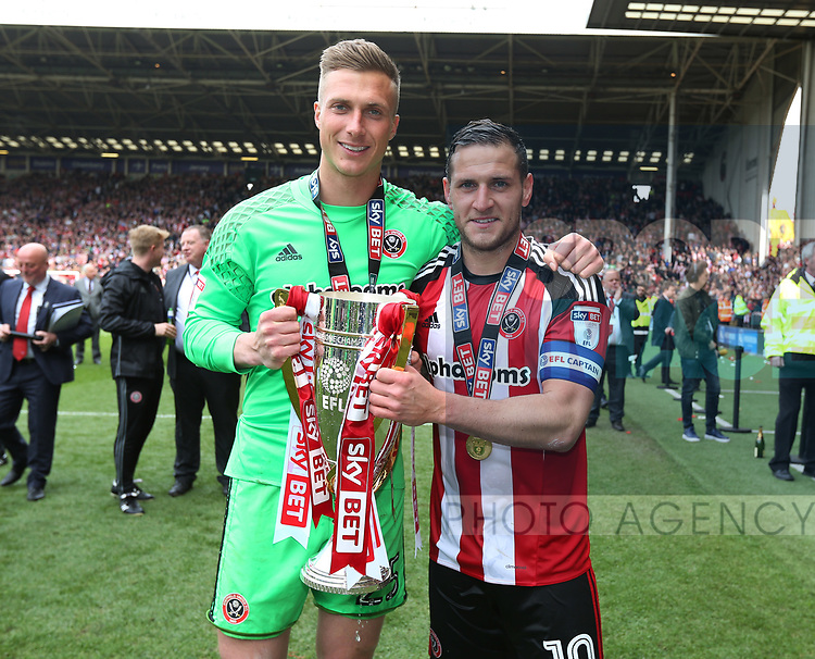 Sheffield United's Simon Moore and Billy Sharp celebrate with the trophy during the League One match at Bramall Lane, Sheffield. Picture date: April 30th, 2017. Pic David Klein/Sportimage