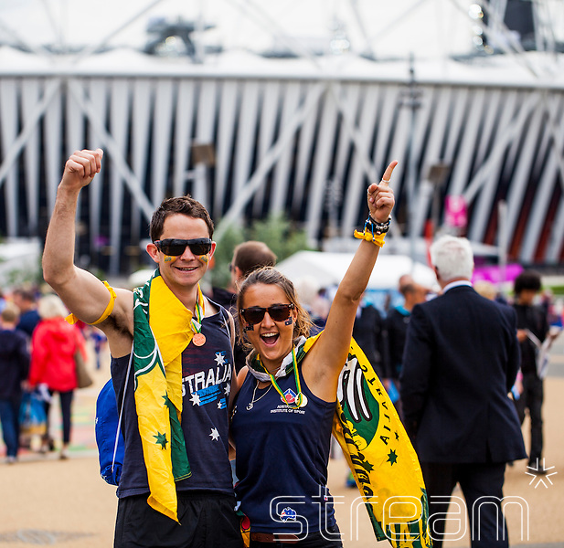 A Male and Female Australian fan, smiling outside the Olympic stadium in the Olympic park, London 2012