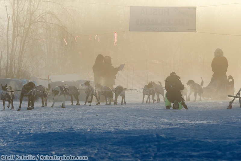 Charlie Bejna arrives and checks into the Huslia checkpoint in the fog on Saturday  March 14, 2015 during Iditarod 2015.  <br /> <br /> (C) Jeff Schultz/SchultzPhoto.com - ALL RIGHTS RESERVED<br />  DUPLICATION  PROHIBITED  WITHOUT  PERMISSION