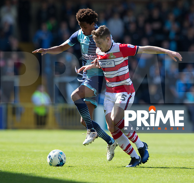 Sido Jombati of Wycombe Wanderers battles with Mathieu Baudry of Doncaster Rovers during the Sky Bet League 2 match between Wycombe Wanderers and Doncaster Rovers at Adams Park, High Wycombe, England on 22 April 2017. Photo by James Williamson / PRiME Media Images.