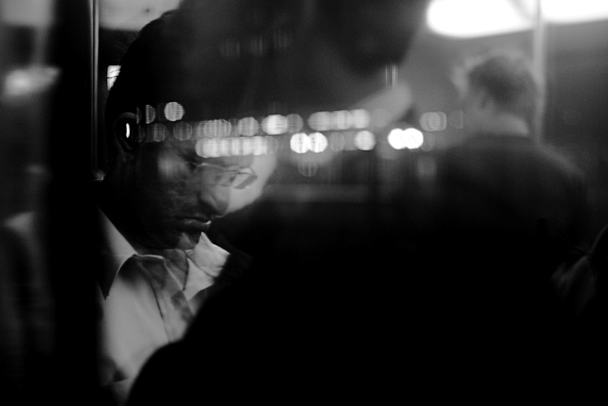 A commuter is seen reflected in a window on a suburban train, inner Sydney, March 2007. Photo: Ed Giles.