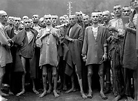 "May 7, 1945. - Starved prisoners, nearly dead from hunger, pose in concentration camp in Ebensee, Austria. The camp was reputedly used for ""scientific"" experiments. It was liberated by the 80th Division. May 7, 1945. Lt. A. E. Samuelson. (Army)"