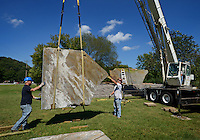 NWA Democrat-Gazette/BEN GOFF @NWABENGOFF<br /> Mark Daniels (left) with Sign Studio based in Cave Springs and Kevin Taylor with Multi-Craft Contractors based in Springdale guide stone slab into place on Thursday Sept. 17, 2015 as a crew builds a new welcome sign along Highway 71 next to Lake Bella Vista. The crew is working on two similar signs, the other on Highway 71 near the Northern city limits, made from sandstone slabs quarried in Scranton. The signs will read 'Bella Vista' with LED halo lighting that can be programed to show different colors for special occasions. Aging wooden signs that previously stood in the same locations were removed last year.