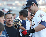 Aces Yunesky Sanchez poses with a young fan before the game.  Photo by Tom Smedes.