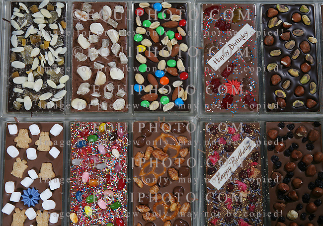 Samples of the many custom chocolate products at Chocomize.com in Cherry Hill, New Jersey sit in mold trays prior to packaging.