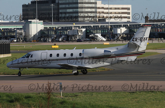 A Netjets Europe Cessna 560XLS Citation Excel Registration CS-DXV taxying at Manchester Airport on 14.2.16.