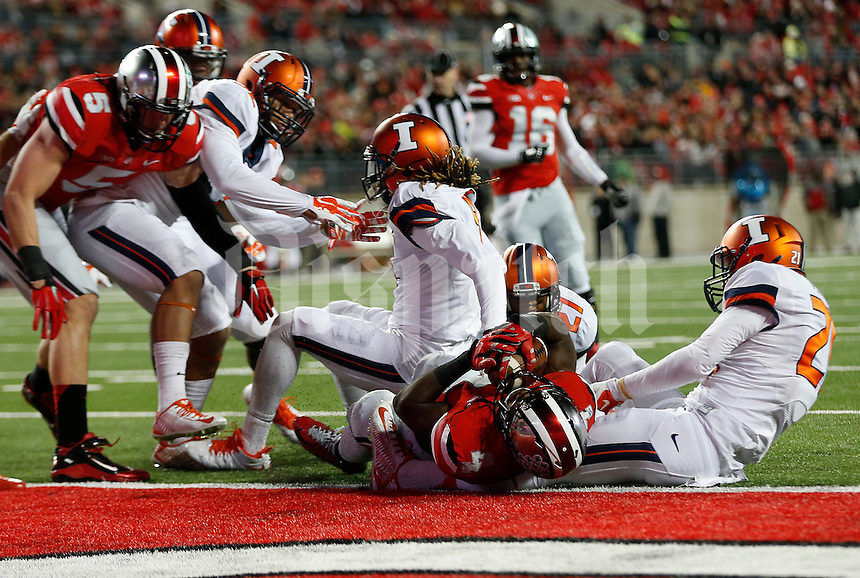 Ohio State Buckeyes running back Curtis Samuel (4) breaks the barrier for a touchdown in the second quarter the college football game between the Ohio State Buckeyes and the Illinois Fighting Illini at Ohio Stadium in Columbus, Saturday night, November 1, 2014. As of half time the Ohio State Buckeyes led the Illinois Fighting Illini 31 - 0. (The Columbus Dispatch / Eamon Queeney)