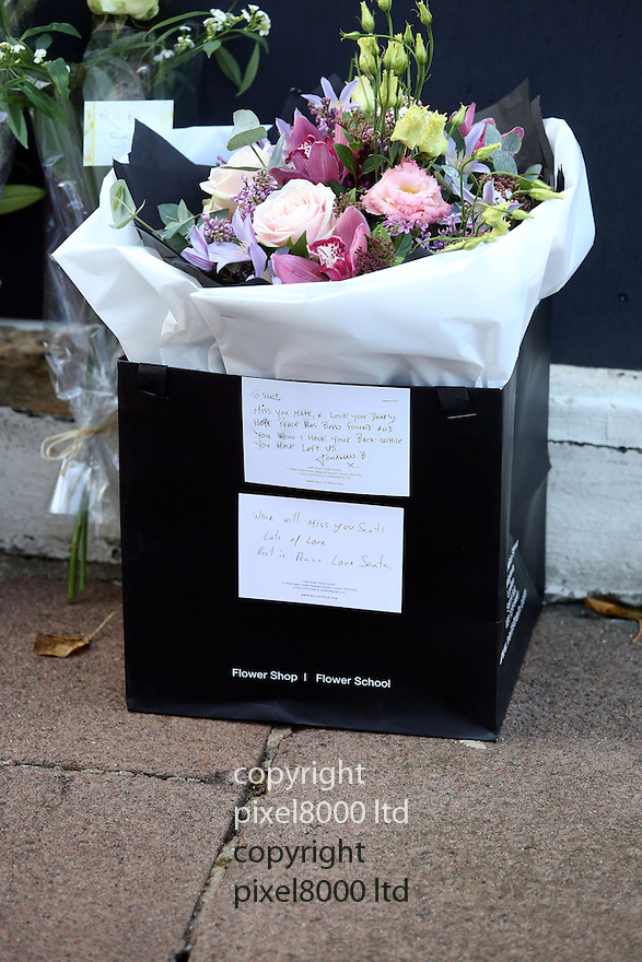 Pic shows: Death scene of Scot Young - ex husband of Michelle Young.<br /> <br /> Grieving friends and mourners left flowers and notes today. 11.12.14<br /> <br /> <br /> <br /> <br /> Pic by Gavin Rodgers/Pixel 8000 Ltd