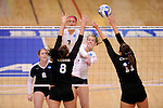 03 DEC 2011:  Cassie Haag (2) of Concordia University St. Paul hits a shot over Samantha Middleborn (8) and Morgan Carty (11) of Cal State San Bernardino during the Division II Women's Volleyball Championship held at Coussoulis Arena on the Cal State San Bernardino campus in San Bernardino, Ca. Concordia St. Paul defeated Cal State San Bernardino 3-0 to win the national title. Matt Brown/ NCAA Photos