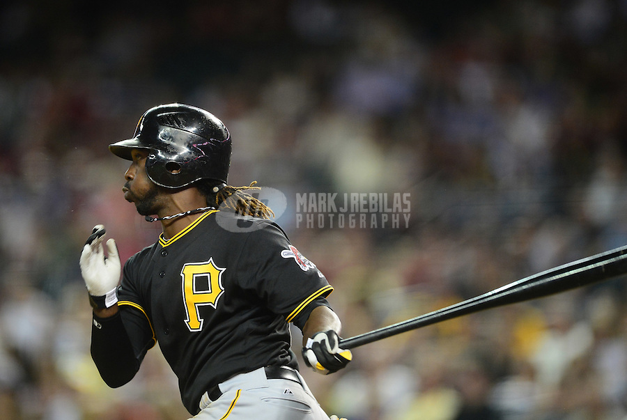 Apr. 17, 2012; Phoenix, AZ, USA; Pittsburgh Pirates outfielder Andrew McCutchen hits an eighth inning single against the Arizona Diamondbacks at Chase Field. The Pirates defeated the Diamondbacks 5-4. Mandatory Credit: Mark J. Rebilas-