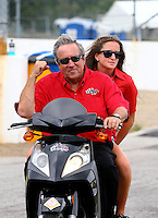 Sept. 1, 2013; Clermont, IN, USA: NHRA team owner, Don Schumacher celebrates with daughter Megan Schumacher during  the US Nationals at Lucas Oil Raceway. Mandatory Credit: Mark J. Rebilas-