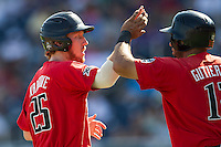 Texas Tech Red Raiders third baseman Hunter Hargrove (25) is greeted by teammate Eric Gutierrez (12) after scoring against the TCU Horned Frogs in Game 3 of the NCAA College World Series on June 19, 2016 at TD Ameritrade Park in Omaha, Nebraska. TCU defeated Texas Tech 5-3. (Andrew Woolley/Four Seam Images)