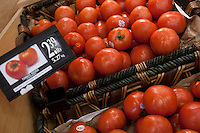 A tomato basket is seen in a Metro grocery store in Quebec city March 4, 2009.