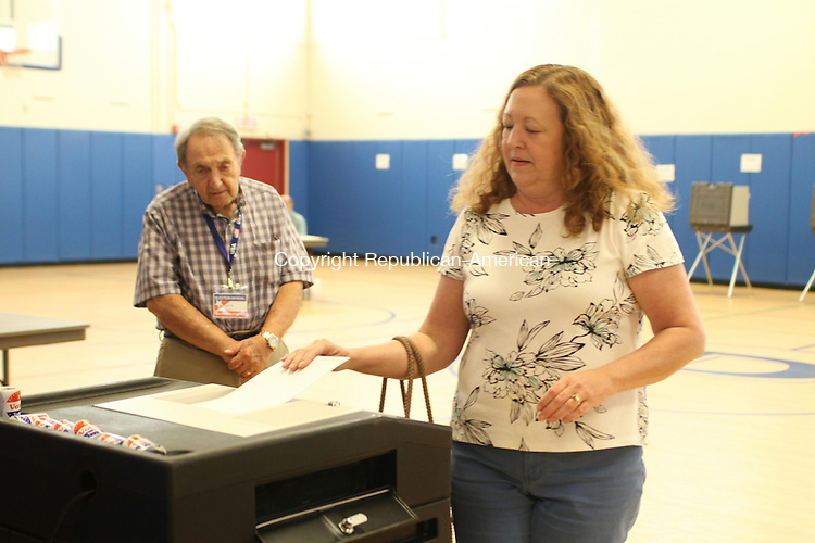 WATERTOWN, CT, 24 June 2014-062414LW04 -  Cheryl Way casts her ballot at Polk School in Watertown for the budget referendum Tuesday as machine tender Carmine Marchitto, left, looks on. Laraine Weschler Republican-American