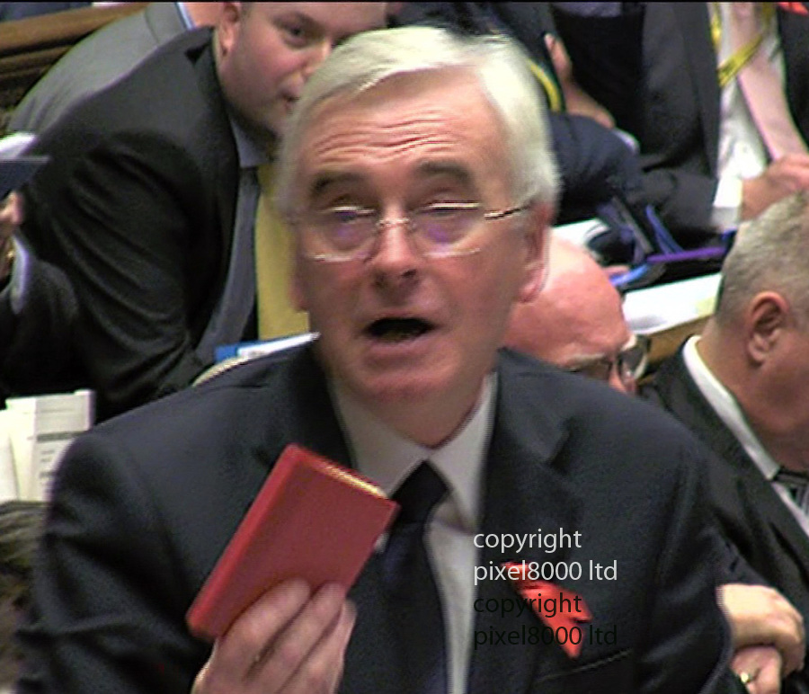Pic shows: Autumn Statement 2015<br /> <br /> Shadow Chancellor John McDonnell produces Chairman Mao's Little Red Book and quotes from it.<br /> <br /> <br /> after<br /> Chancellor George Osborne huge U-turn on tax credits.<br /> <br /> <br /> <br /> Picture by Pixel8000 07917221968