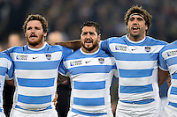 Julian Montoya, Horacio Agulla and Juan Martin Fernandez Lobbe of Argentina sing their national anthem. Rugby World Cup Bronze Final between South Africa and Argentina on October 30, 2015 at The Stadium, Queen Elizabeth Olympic Park in London, England. Photo by: Patrick Khachfe / Onside Images