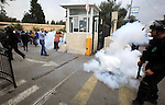 Israeli policemen fire tear gas towards Palestinian doctors and medical employees as they take part in a protest outside the al-Makassed Hospital against the storming of the hospital by Israeli police, in east Jerusalem on October 29, 2015. Palestinian Minister of health Jawad Awwad denounced storming al-Makassed Hospital for the third time in a month, attacking staff and firing teargas canisters within the premises. He called on the international community to immediately interfere to put an end to Israeli crimes against the Palestinians. Photo by Mahfouz Abu Turk