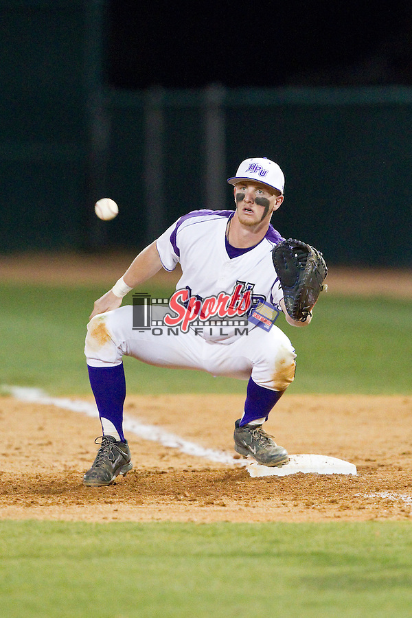 Spencer Angelis (11) of the High Point Panthers waits for a throw at first base during the game against the Coastal Carolina Chanticleers at Willard Stadium on March 14, 2014 in High Point, North Carolina.  The Panthers defeated the Chanticleers 3-0.  (Brian Westerholt/Sports On Film)