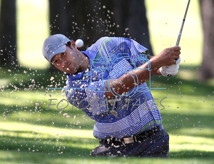 Dallas Cowboys quarterback Tony Romo hits out of the sand during a practice round at the 22nd American Century Celebrity Golf Championship at Edgewood Tahoe Golf Course in Stateline, Nev., on Wednesday, July 13, 2011. .Photo by Cathleen Allison