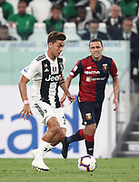 Calcio, Serie A: Juventus - Genoa, Turin, Allianz Stadium, October 20, 2018.<br /> Juventus' Paulo Dybala (l) in action with Genoa's Romulo (r) during the Italian Serie A football match between Juventus and Genoa at Torino's Allianz stadium, October 20, 2018.<br /> UPDATE IMAGES PRESS/Isabella Bonotto