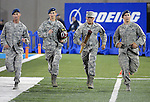 September 12, 2015 - Colorado Springs, Colorado, U.S. - In remembrance of the 9/11 tragedy, Air Force Cadets have been running continuously since Friday with a fire helmet and torch to honor those who died.  At halftime, a team of cadets enter the stadium and conclude the run during Mountain West Conference action between the San Jose State Spartans and the Air Force Academy Falcons at Falcon Stadium, U.S. Air Force Academy, Colorado Springs, Colorado.  Air Force defeats San Jose State 37-16.