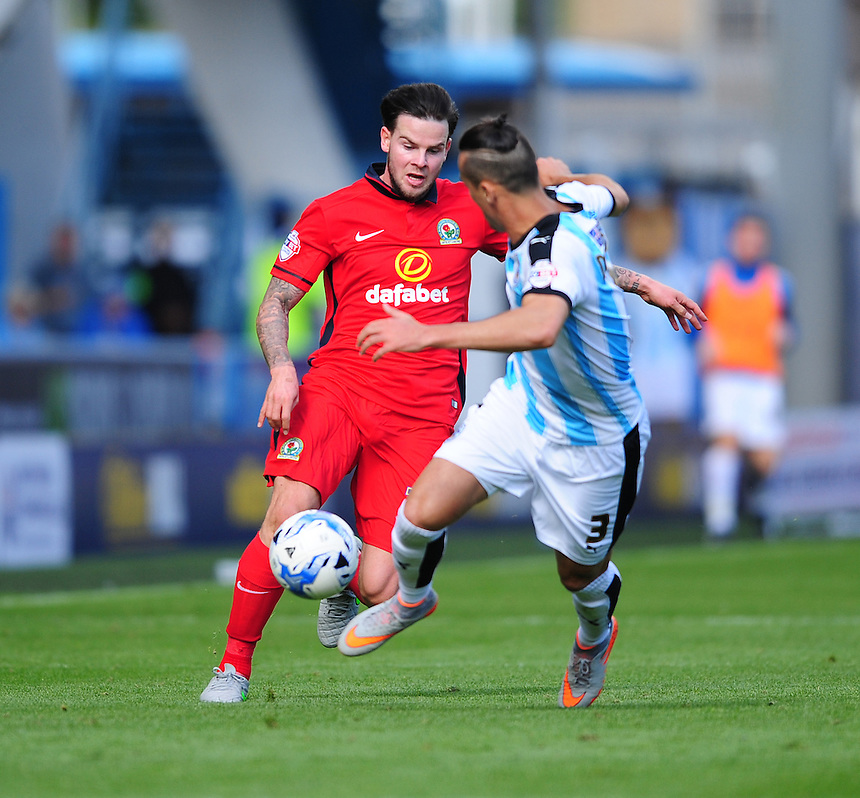 Blackburn Rovers' Danny Guthrie vies for possession with Huddersfield Town's Jason Davidson<br /> <br /> Photographer Chris Vaughan/CameraSport<br /> <br /> Football - The Football League Sky Bet Championship - Huddersfield Town v Blackburn Rovers - Saturday 15th August 2015 - The John Smith's Stadium - Huddersfield<br /> <br /> &copy; CameraSport - 43 Linden Ave. Countesthorpe. Leicester. England. LE8 5PG - Tel: +44 (0) 116 277 4147 - admin@camerasport.com - www.camerasport.com